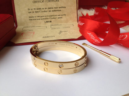 Yellow gold Cartier love bracelet 4 diamonds