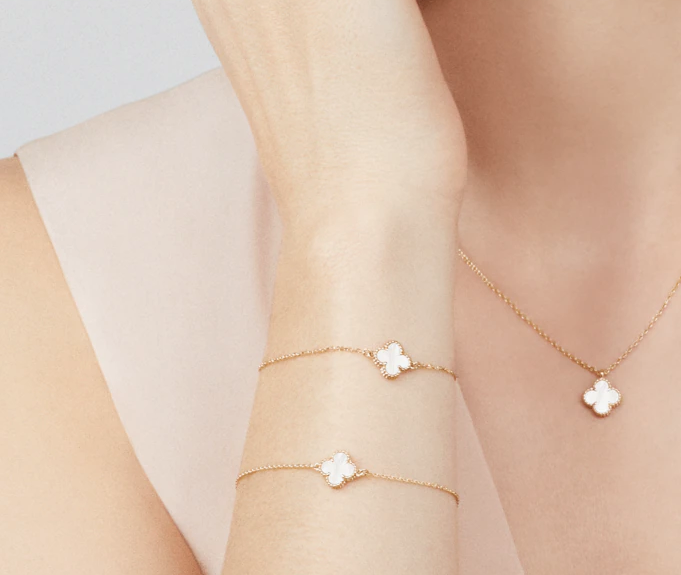 Van Cleef & Arpels Sweet Alhambra bracelet & necklace yellow gold white mother-of-pearl